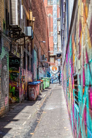 croft: MELBOURNE, AUSTRALIA - MARCH 21, 2015: People looking the colorful graffiti in dead end of the Croft alley in downtown.