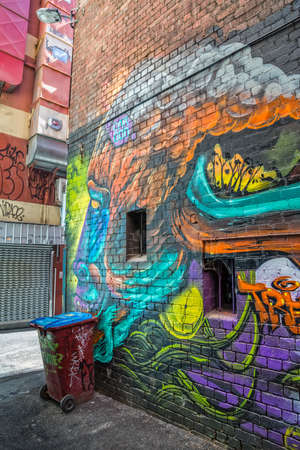 croft: MELBOURNE, AUSTRALIA - MARCH 21, 2015: Colorful graffiti in Croft Alley of downtown, depicts an monkey profile on the corner of a building.
