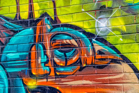 sprayed: MELBOURNE, AUSTRALIA - MARCH 21, 2015: Colorful graffiti detail in back of Croft alley of downtown.