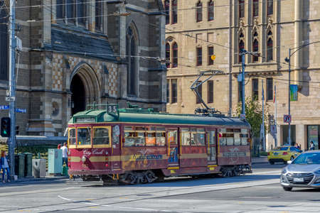 informative: MELBOURNE, AUSTRALIA - MARCH 21, 2015: The historic and informative City Circle Tram popular with tourists travels passes by the St. Paul Cathedral.