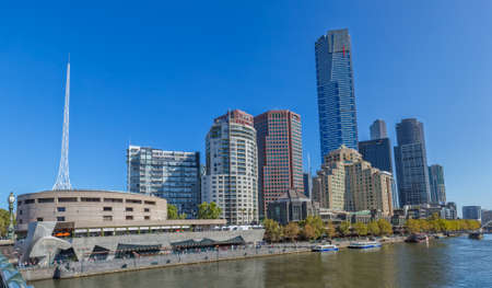 skylines: MELBOURNE, AUSTRALIA - MARCH 21, 2015: Panoramic view of Southbank high skylines and buildings from Princes bridge on the beautiful sunny day.
