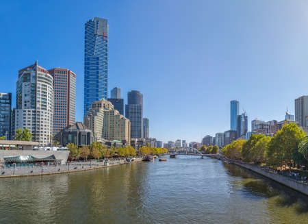 southgate: MELBOURNE, AUSTRALIA - MARCH 21, 2015: Panoramic view of Yarra river flowing thru the city on the beautiful sunny day.