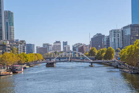 southgate: MELBOURNE, AUSTRALIA - MARCH 21, 2015: View of Southbank footbridge and Sandridge bridge on Yarra river on the beautiful sunny day. Editorial