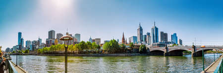 southbank: MELBOURNE, AUSTRALIA - MARCH 21, 2015: Panoramic view of city from Southbank showing Princes bridge, old central buildings and apartment architecture on the beautiful sunny day. Editorial