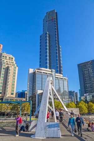 southgate: MELBOURNE, AUSTRALIA - MARCH 21, 2015: View of the Southbank Eureka tower from the footbridge on the beautiful sunny day.