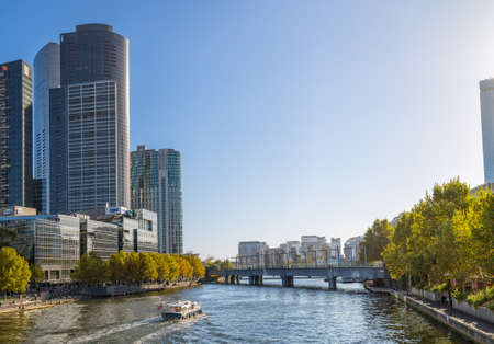 southgate: MELBOURNE, AUSTRALIA - MARCH 21, 2015: Skyline of Melbourne with Old Sandridge Rail Bridge and Yarra River.