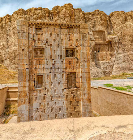 surviving: Naqsh-e Rustams historical monument Cube of Zoroaster is enigmatic structure and one of many surviving examples of the Achaemenid architectural design. Stock Photo