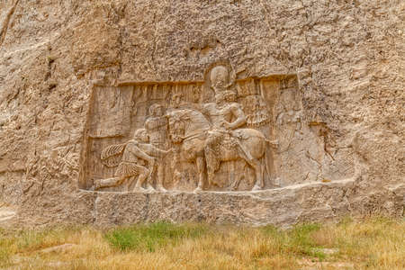 Ancient relief of the necropolis Naqsh-e Rustam that shows the triumph of Shapur I over the Roman Emperor Valerian and Philip the Arab.