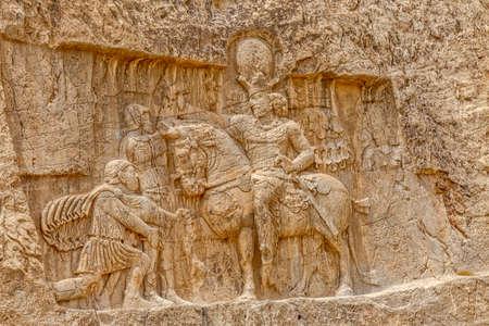 fars: Ancient relief of the necropolis Naqsh-e Rustam that shows the triumph of Shapur I over the Roman Emperor Valerian and Philip the Arab.