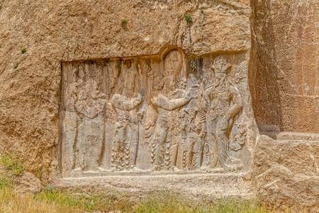 fars: Ancient relief of the necropolis Naqsh-e Rustam that shows the ordination of Narseh by goddess Anahita, Iran, Sasanian civilization 4th century AD.