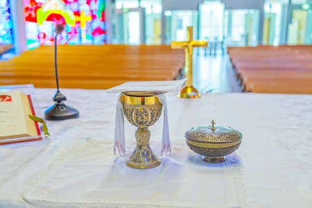 leopold: MELBOURNE, AUSTRALIA - MARCH 19, 2015: Liturgical vessels on the altar of the beautiful Catholic church Saint Leopold Mandic in Sunshine.