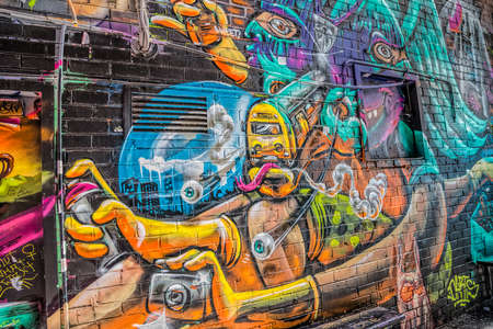 croft: MELBOURNE, AUSTRALIA - MARCH 21, 2015: Colorful graffiti detail in back of Croft alley of downtown.