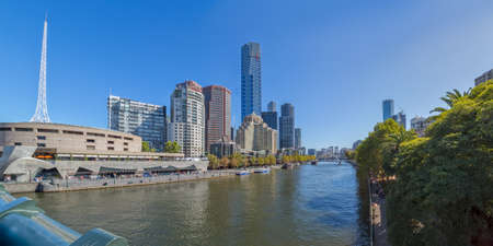 southgate: MELBOURNE, AUSTRALIA - MARCH 21, 2015: Panoramic view of Southbank high skylines and buildings, one of the primary business centers and also one of the most densely populated areas on the beautiful sunny day.