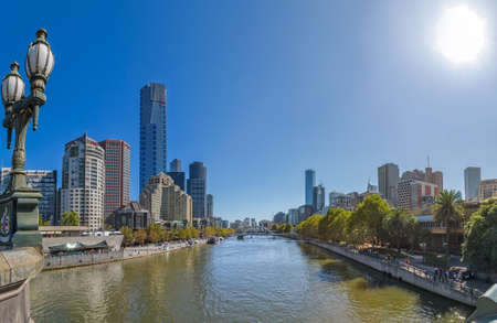 southgate: MELBOURNE, AUSTRALIA - MARCH 21, 2015: Panoramic view of Yarra river flowing thru the city, from Princes bridge on the beautiful sunny day.