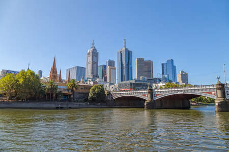 southbank: MELBOURNE, AUSTRALIA - MARCH 21, 2015: View of Princes bridge from Southbank showing Cathedral of Saint Paul and apartment architecture on the beautiful sunny day.
