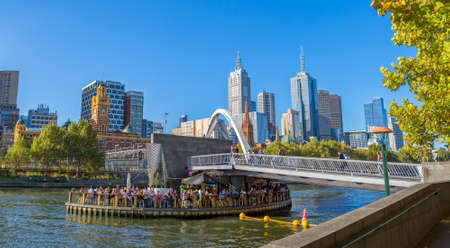 southgate: MELBOURNE, AUSTRALIA - MARCH 21, 2015: View of Southbank footbridge and its Ponyfish Island restaurant on Yarra river on the beautiful sunny day. Editorial