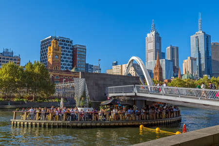 southbank: MELBOURNE, AUSTRALIA - MARCH 21, 2015: View of Southbank footbridge and its Ponyfish Island restaurant on Yarra river on the beautiful sunny day. Editorial
