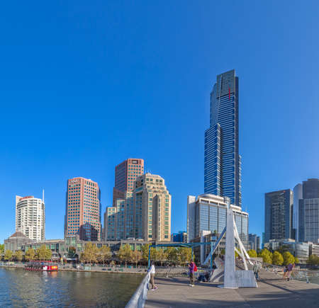 southbank: MELBOURNE, AUSTRALIA - MARCH 21, 2015: View of the Southbank high skylines and buildings from the footbridge on the beautiful sunny day.