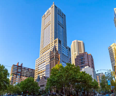 uniting: MELBOURNE, AUSTRALIA - MARCH 21, 2015: St Michaels Uniting Church tower with modern building, famous landmark of Melbourne on the Collins and Russel Streets corner. Editorial