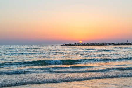 Beautiful sea sunset in Tel Aviv on Metzitzim beach, Israel.