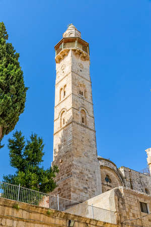sepulchre: Omer mosque minaret in front of the Church of the Holy Sepulchre in Jerusalem, Israel. Stock Photo