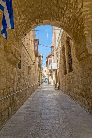 mid afternoon: JERUSALEM, ISRAEL - JUNE 19, 2015: Quiet afternoon at the narrow street of the old town. Editorial