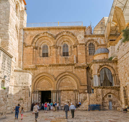 sepulchre: JERUSALEM, ISRAEL - JUNE 19, 2015: Tourists and pilgrims walking at the main entrance of the Church of the Holy Sepulchre in Old City.