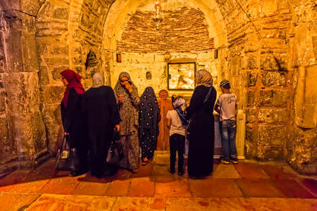 sepulchre: JERUSALEM, ISRAEL - JUNE 19, 2015: People make pilgrimages to the bottom of the Golgotha in Church of the Holy Sepulchre. Editorial