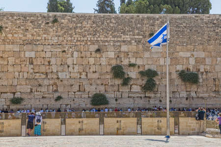 JERUSALEM, ISRAEL - JUNE 19, 2015: Big flag at the Western Wall, Wailing Wall or Kotel is located in the Old City of Jerusalem at the foot of the western side of the Temple Mount. Editorial