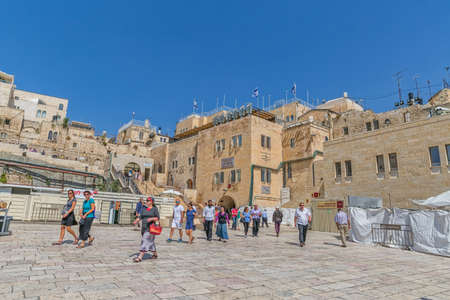 wailing: JERUSALEM, ISRAEL - JUNE 19, 2015: Tourists walking to the Western Wall, Wailing Wall or Kotel is located in the Old City of Jerusalem at the foot of the western side of the Temple Mount.