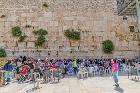 kotel: JERUSALEM, ISRAEL - JUNE 19, 2015: Women praying at the Western Wall, Wailing Wall or Kotel is located in the Old City of Jerusalem at the foot of the western side of the Temple Mount.