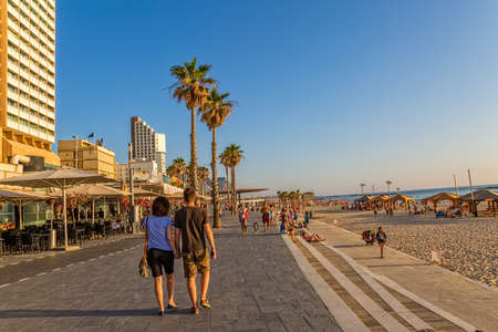 TEL AVIV, ISRAEL - JUNE 18, 2015: People walking the long promenade by the beach.
