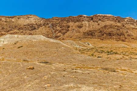 israelis: Israelis dry and sandy stone desert landscape by the Dead sea.