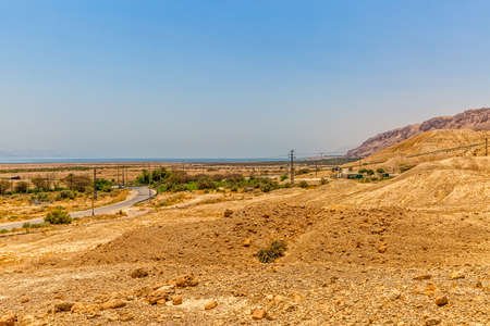 israelis: Israelis dry and sandy road landscape by the Dead sea. Stock Photo