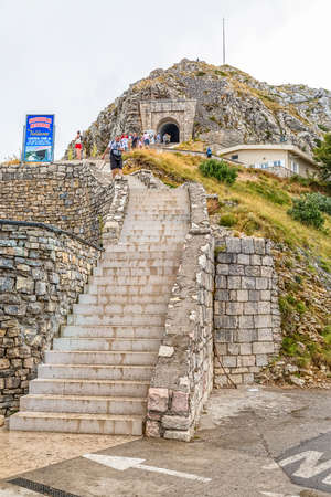 southwestern: LOVCEN, MONTENEGRO - AUGUST 11, 2015: People at the stairs to the tunnel on the way to the Njegos mausoleum in Lovcen mountain and national park in southwestern Montenegro. Editorial