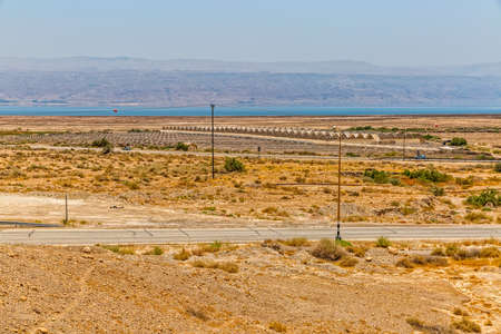 israelis: Israelis dry and sandy road landscape by the Dead sea and plantation of vegetables.