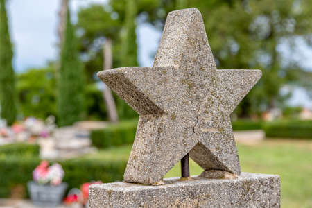 Concrete five-pointed star detail on grave of the partisan soldier in Tucepi, Croatia.