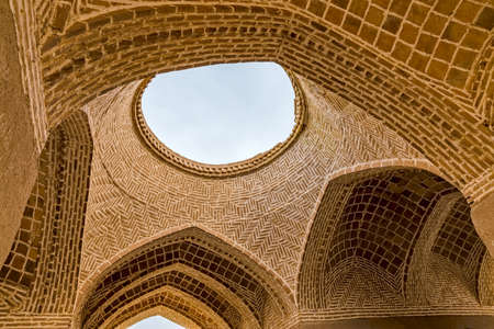 architectural tradition: Disused old building interior at the foot of the hill with Towers of Silence in Yazd, Iran.