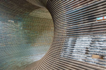 deconstruct: Metal tunnel made of rounded steel pipes.