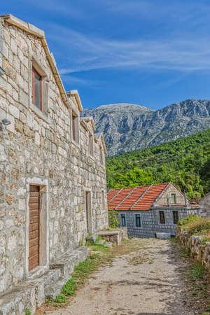 croatian: Tucepi is the Dalmatian village in the slope of a mountain Biokovo. Stock Photo