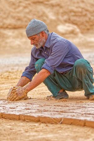 Brickman making bricks