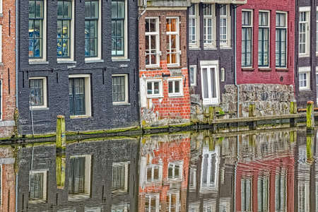Amsterdam old houses reflection in river Amstel
