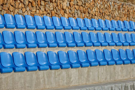 Blue Chairs At The Stadium Imagens - 128659971