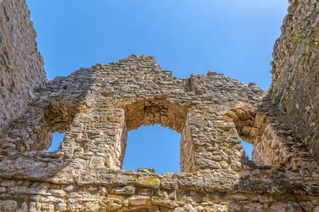 Windows at west side of the ruins of early pre-romanesque Church of Holy Salvation near small town Vrlika in Cetina village. Stock Photo
