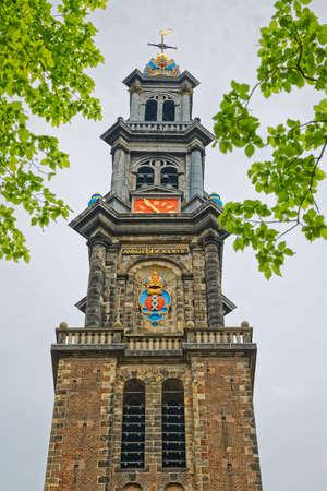 Amsterdam Westerkerk clock tower in spring time Фото со стока