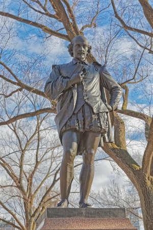 NEW YORK, USA - JANUARY 15, 2018: William Shakespeare bronze sculpture in Central Park in winter season.