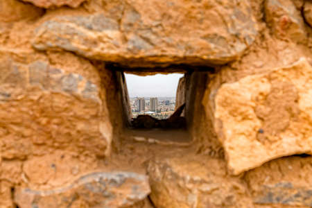 A small window on top of demolished building of the tower of silence in Yazd, Iran.