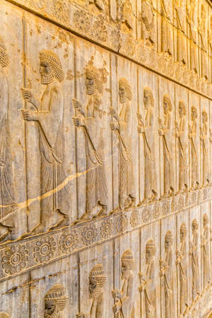 Guardians also known as the Immortals holding a spear, relief detail on the stairway facade of the Apadana at the old city Persepolis. Reklamní fotografie