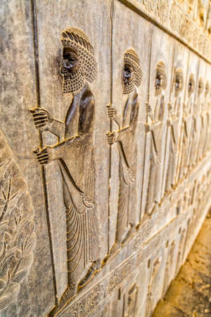 Guardians also known as the Immortals holding a spear, relief detail on the stairway facade of the Apadana at the old city Persepolis. 스톡 콘텐츠