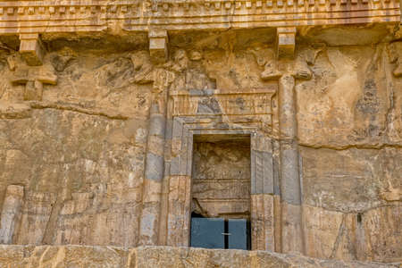 Royal tombs entrance door on the hill in old city Persepolis, a capital of the Achaemenid Empire 550 - 330 BC. Reklamní fotografie